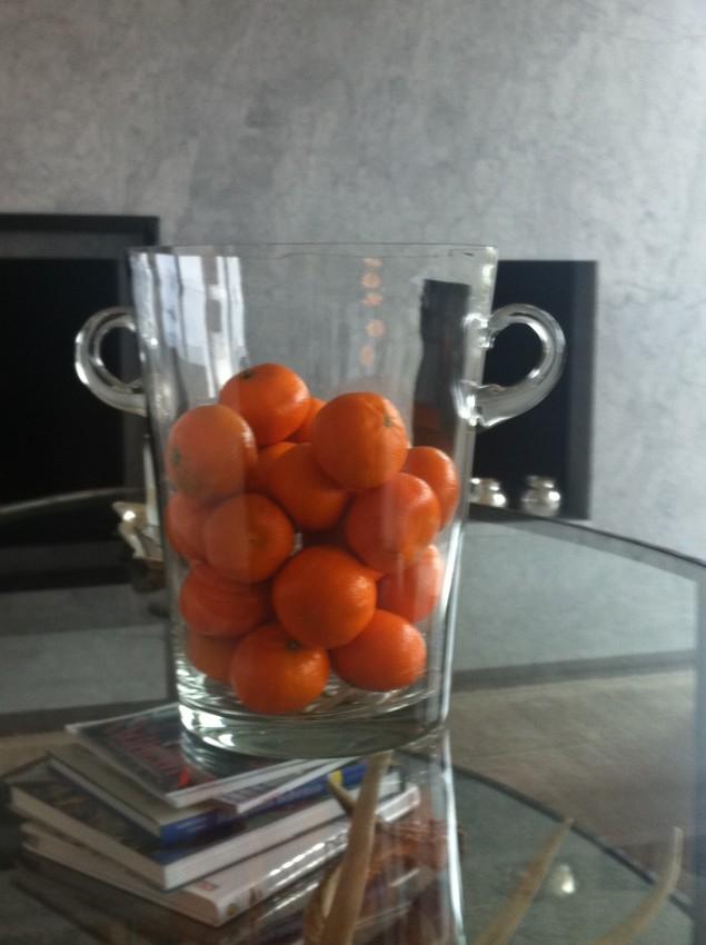 burst of orange, mandarins in a champagne bucket